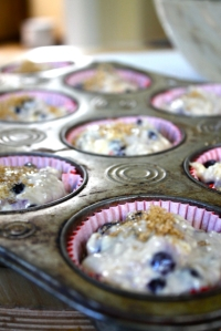 in tins - topped with sugar sprinkle